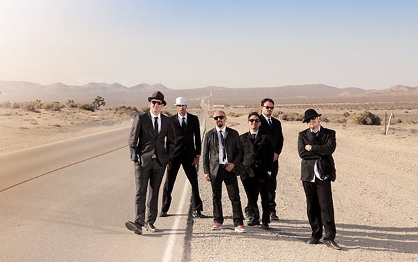 The headliners at this summer's inaugural Ruido Fest include the nattily dressed fellows in Ozomatli.
