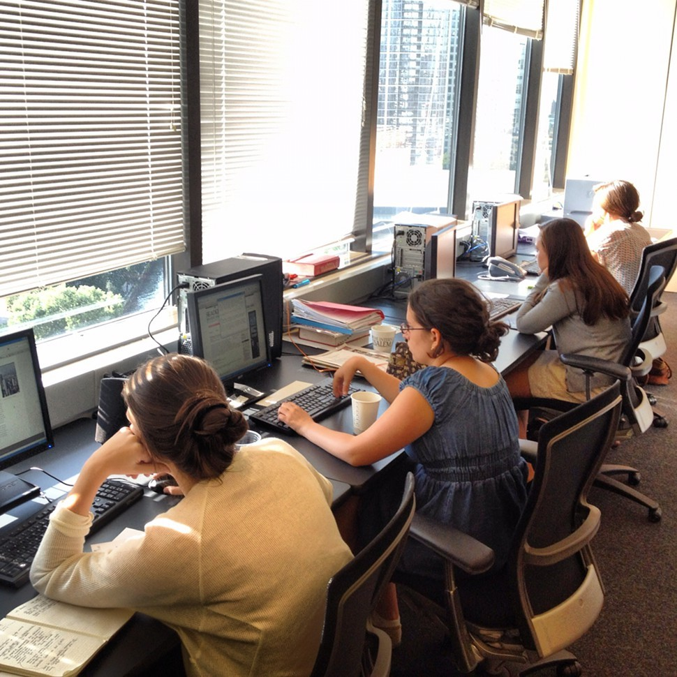 The interns hard at work—despite their stunning (invisible here but trust me) view