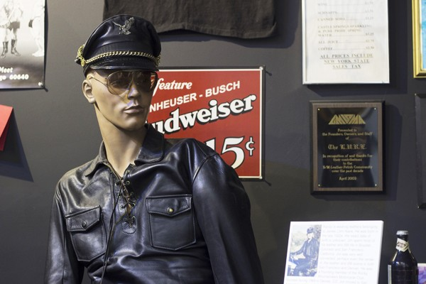 "The Leather Archives & Museum's bar exhibit ""regular,"" Randy, watches over a collection of nightlife artifacts."