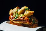 The po'boy stuffed with lobster, foie gras, and deep-fried oysters is an example of tasteful balance despite itself. - JEFFREY MARINI
