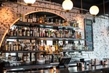 The restaurant's handsome bar - MICHELLE SANGSTER