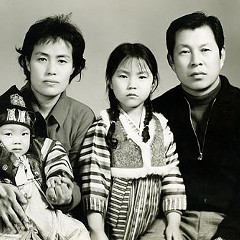 The Suh family (Andrew left, Catherine standing center)
