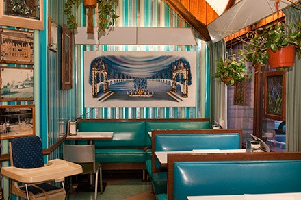 The turquoise-bedecked dining room at Johnsen's Blue Top Drive-In