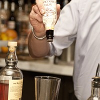 """Patrick Henagahn makes the I Must Have Flown the Coop Then add three dashes of Fee Brothers Aztec Chocolate bitters. """"It was the only thing we found that could cover up"""" the """"fake chicken flavor,"""" said Henaghan. Andrea Bauer"""