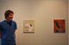 Tim Nickodemus next to his paintings Charts, 2011 and Moss, 2011