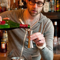 Step-by-step instructions for making Jay Schroeder's PEZ cocktail To that add three quarters of an ounce of Dubonnet Rouge, a wine-based aperitif that gives the drink its rosy tinge. Andrea Bauer