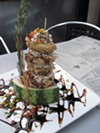 Tower of fried green tomatoes, chicken salad, etc