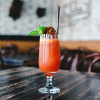 A Charlatan bartender subdues an ingredient that smells like dead people