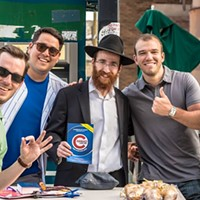 A Hasidic rabbi outside Wrigley Field teaches Cubs fans how to bless their team