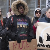 Protest and prayer outside R. Kelly's West Loop studio