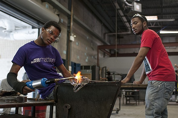 Alex Harris and N'Kosi Barber work together at Ignite Glass Studios. - ANDREA BAUER