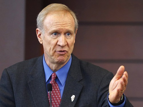 Governor Bruce Rauner has yet to act on a number of bills to reduce the incarcerated population. - CHARLES REX ARBOGAST/AP PHOTO
