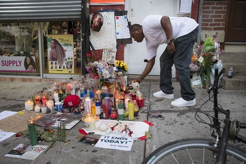 Objective journalism went awry in the wake of Eric Garner's death. - JOHN MINCHILLO/AP