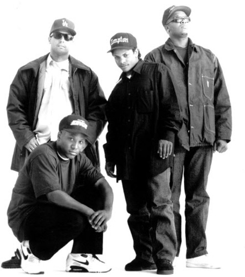 N.W.A after Ice Cube left the group. From left to right: Yella, MC Ren (crouching), Eazy-E, and Dr. Dre. - SUN-TIMES MEDIA