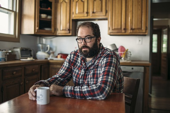 Ashworth in his kitchen, which is miraculously clean considering that he and his wife have two kids younger than four - JEFFREY MARINI