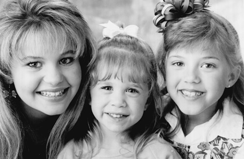 Sweetin (right) with onscreen sisters Candace Cameron and, well, one of the Olsen twins