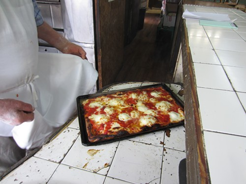 A thicker sheet pizza at Di Fara - MICHAEL GEBERT