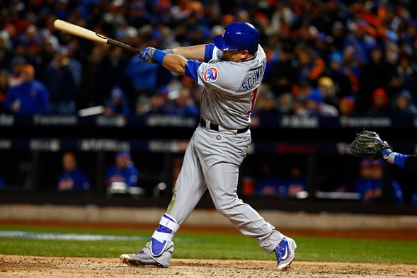 Kyle Schwarber slugs one out in Saturday's game against the Mets. - (MIKE STOBE/GETTY IMAGES)
