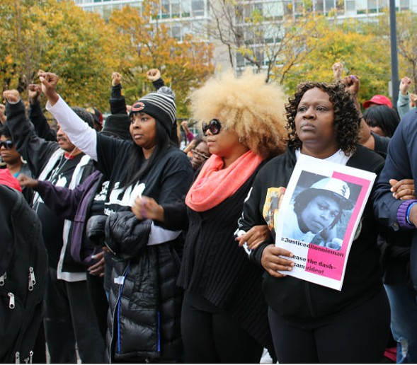 Dorothy Holmes, right, carried a picture of her son, Ronald Johnson. - (TATIANA WALK-MORRIS)