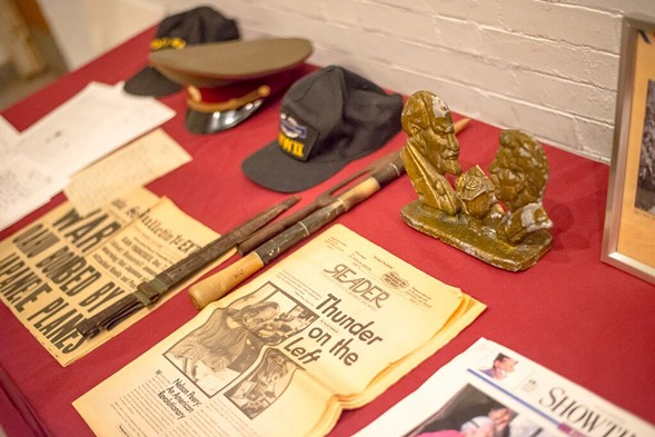 Items from Peery's life—including a veteran's cap and Soviet paraphernalia—on display at his memorial. - (BRETT JELINEK)