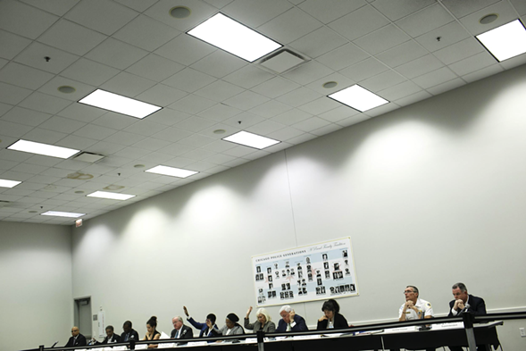 The Chicago Police Board votes during its November 19 meeting. - JONATHAN GIBBY