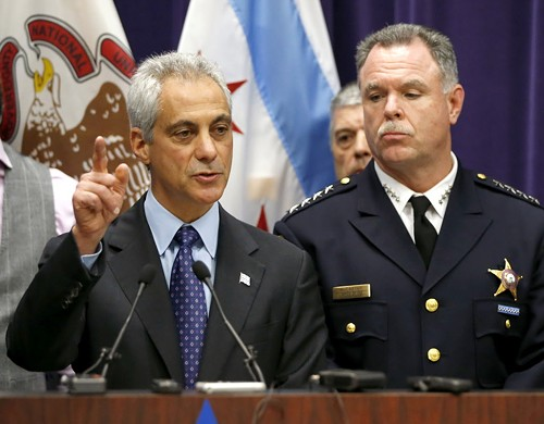 Mayor Emanuel and police superintendent Garry McCarthy at a press conference yesterday afternoon. - AP PHOTO/CHARLES REX ARBOGAST