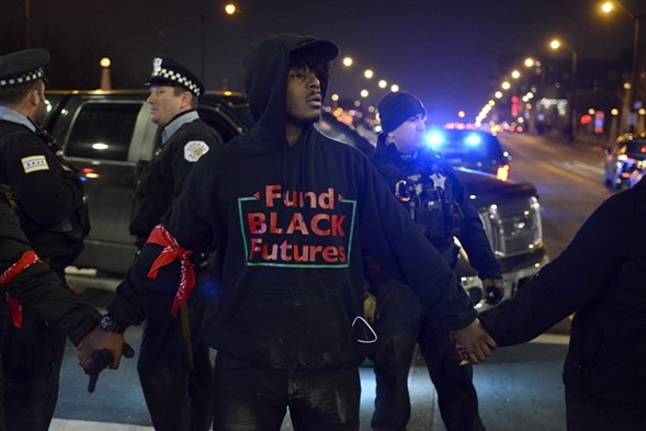 Activist and poet Malcolm London was arrested during the Laquan McDonald protests Tuesday night. - AP PHOTO/PAUL BEATY