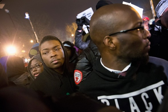 """Demonstrators gathered outside Chicago police headquarters for a prayer vigil Monday night. Participants in previous protests asked journalists to respect their desire for """"black-only"""" space. - SCOTT OLSON/GETTY IMAGES"""
