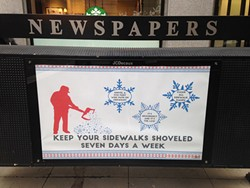 An ad on a Loop newspaper rack reminds residents to shovel. - JOHN GREENFIELD