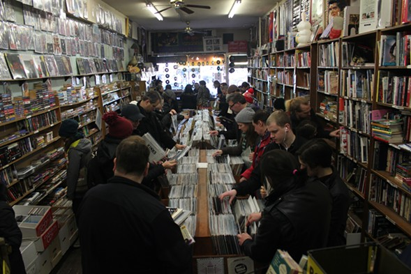 A seemingly endless stream of customers browse the shop's stacks of vinyl, books, CDs, old magazines, band posters, and random junk. - MICAH UETRICHT