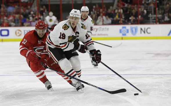 Blackhawks captain Jonathan Toews in Tuesday's game against Raleigh - AP/GERRY BROOME