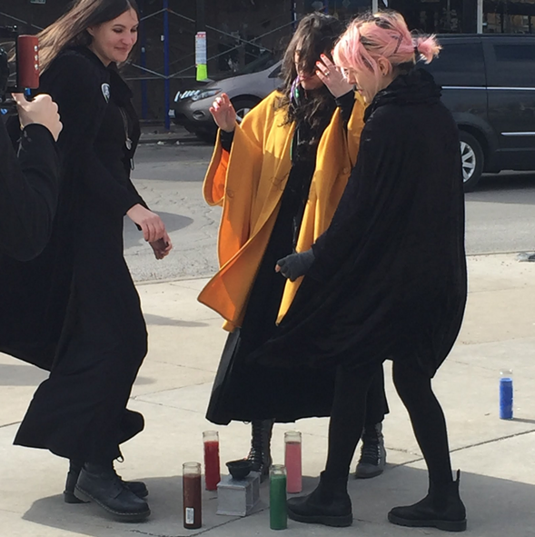 WITCH members Jessica Caponigro, Chiara Galimberti, and Amaranta Isyemille Ramos cast a spell against gentrification in Logan Square. - ZOE GREENBERG