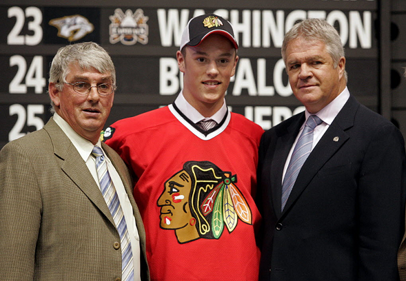 Jonathan Toews poses for a photo with Chicago Blackhawks officials after being selected third overall in the 2006 NHL Draft in Vancouver. - AP PHOTO/CHUCK STOODY, CP