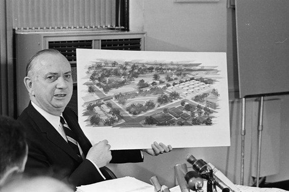 Chicago schools superintendent Benjamin C. Willis holds a watercolor rendering of the planned campus of portable classrooms. - SUN-TIMES