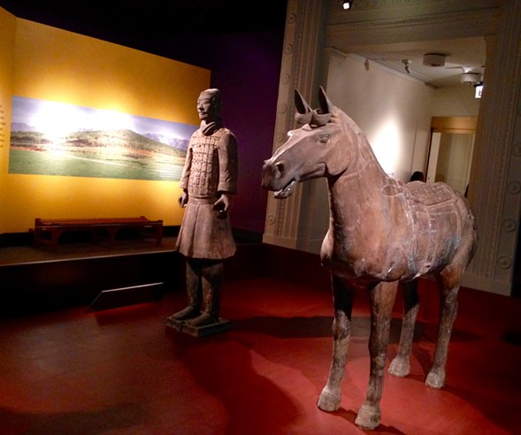 Horse and charioteer. The chariot was made of wood and disintegrated; the exhibit includes a few replicas. - AIMEE LEVITT