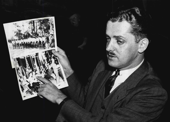 Chicago Daily Times reporter and former FBI agent James C. Metcalfe showing congressional investigators a photo of Kuhn meeting with German consular officials in Chicago. - SUN-TIMES