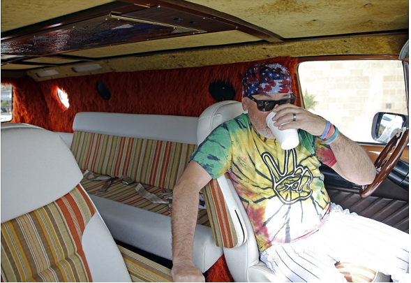 Cubs manager Joe Maddon sits in his van before a late-February practice session. - AP/MORRY GASH