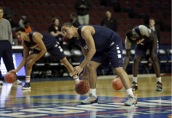 Virginia's Malcolm Brogdon warms up with his teammates during basketball practice in Chicago Thursday. Virginia plays against Iowa State in a regional semifinal game of the NCAA Tournament on Friday. - AP PHOTO/NAM Y. HUH