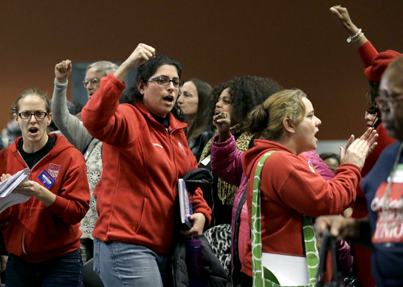 Members of the Chicago Teachers Union cheer during president Karen Lewis speech at a news conference Wednesday. - AP PHOTO/NAM Y. HUH