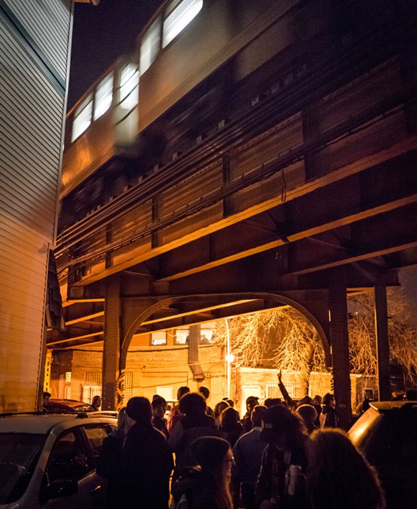 Conversations outside Wally's World have to wait for passing Blue Line trains. - CHRIS RIHA
