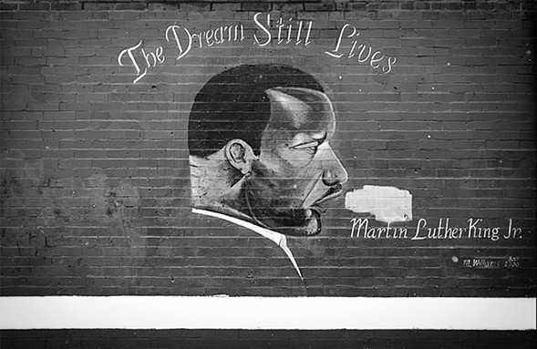 A 2000 mural of Martin Luther King Jr. remains on the north exterior wall of Kohn Elementary School,  April 18, 2013. - JESSICA KOSCIELNIAK/SUN-TIMES