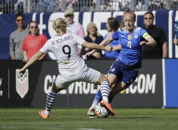 Becky Sauerbrunn, right, faces off against French  forward Eugenie Le Sommer during a SheBelieves Cup  match March 6 in Nashville. - AP PHOTO/MARK HUMPHREY