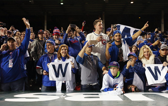 Chicago Cubs fans celebrate after last year's playoff win at Wrigley Field. - JONATHAN DANIEL/GETTY IMAGES