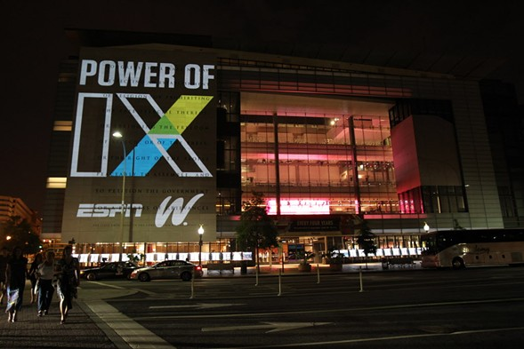EspnW commemorates the 40th anniversary of Title IX by unveiling the world's largest photo mosaic of female athletes upon the Washington Newseum's 74-foot-high First Amendment tablet in June 2012. - PAUL MORIGI/INVISION FOR ESPNW/AP IMAGES