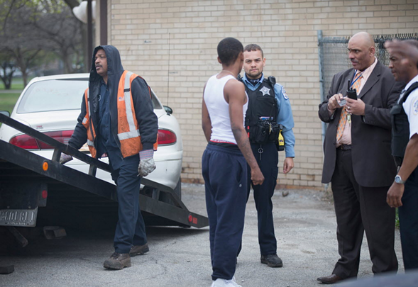 Police investigate the scene of a shooting in Foster Park Monday. - SCOTT OLSON/GETTY IMAGES