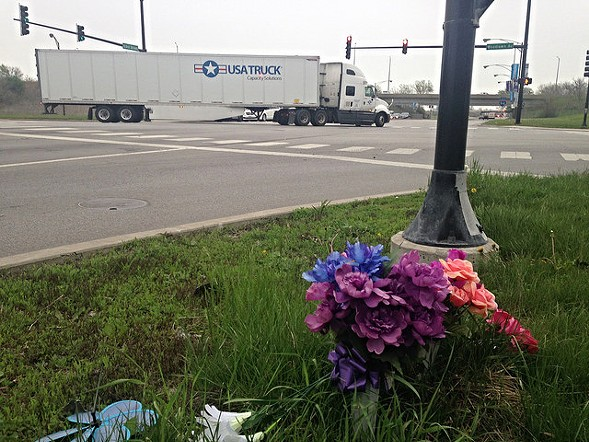 A roadside memorial at Woodlawn and 103rd, a wide road with fast traffic that leads to Big Marsh. A local man was killed here in a May 2015 car crash. - JOHN GREENFIELD