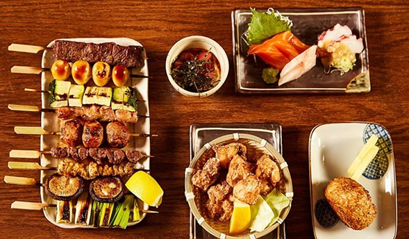 Skewered meats and vegetables, agadashi tofu (second from left), and other items at Yakitori Boogytori - NAGLE PHOTOGRAPHY FOR YAKITORI BOOGYTORI