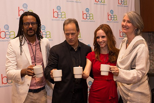 Colson Whitehead, Sebastian Junger, Faith Salle, and Louise Penny toast at the end of their author breakfast on Thursday morning. - COURTESY BEA