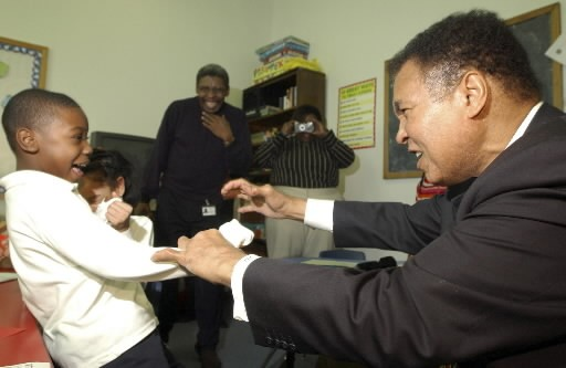 Muhammed Ali plays with Jawil Aldridge while visiting an after-school program on the west side in 2005. - JOHN J. KIM/SUN-TIMES