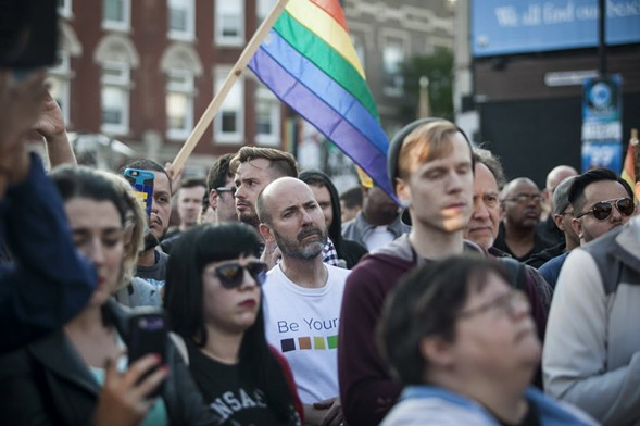 People gathered at the corner of Halsted and Roscoe in Boystown Sunday for a vigil in the wake of the worst mass shooting in U.S. history. - ASHLEE REZIN/SUN-TIMES